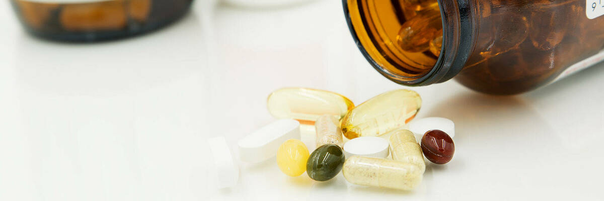 supplement bottles, pills and capsules