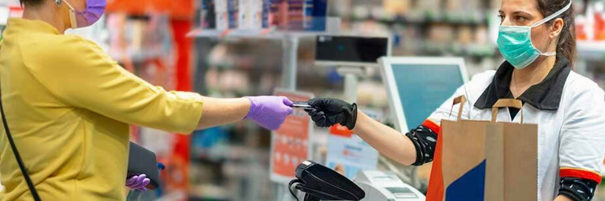 Customer and cashier making a payment in a pharmacy.