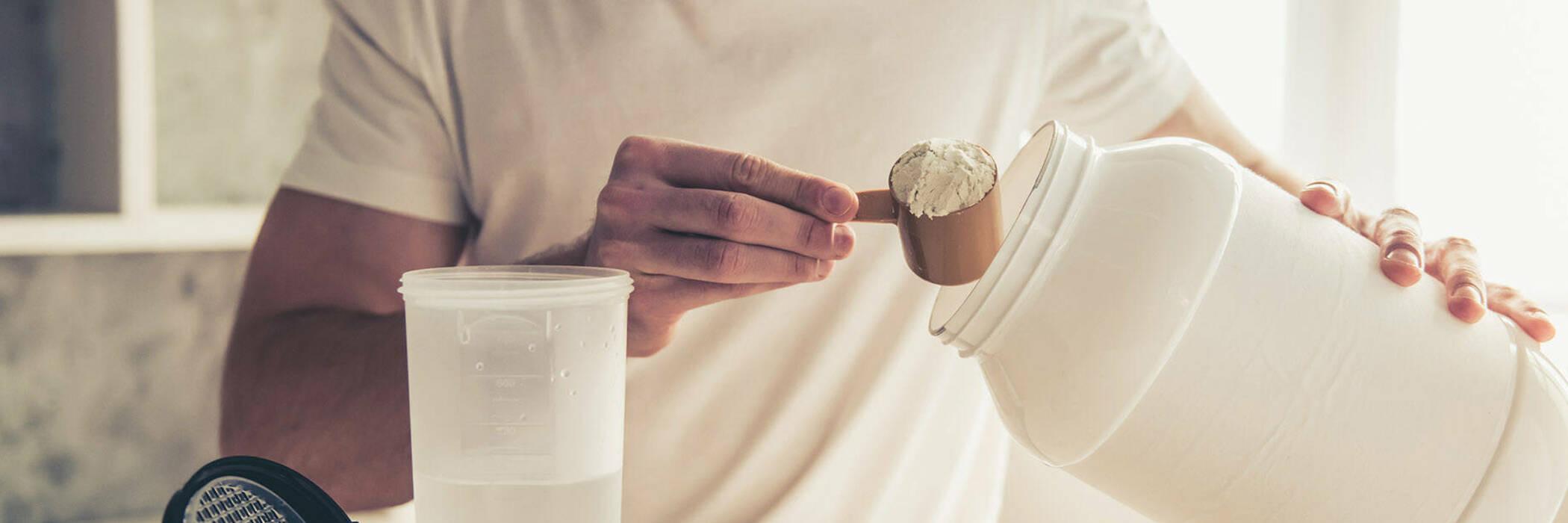 Man preparing protein powder shake