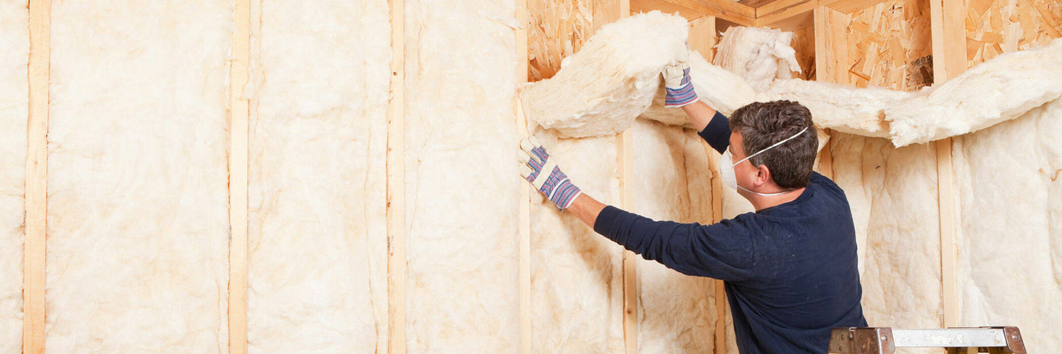Man insulating a wall