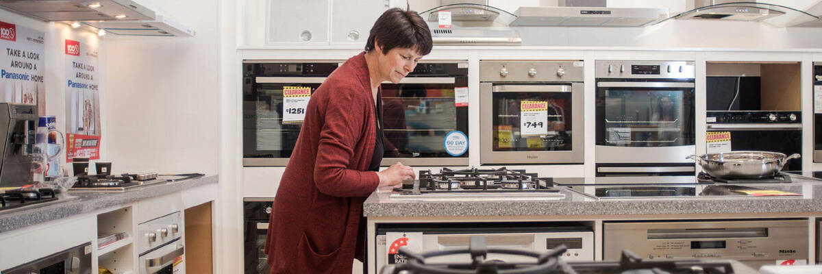 Woman shopping at an appliance store