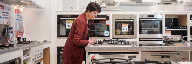 Woman shopping for a stovetop.