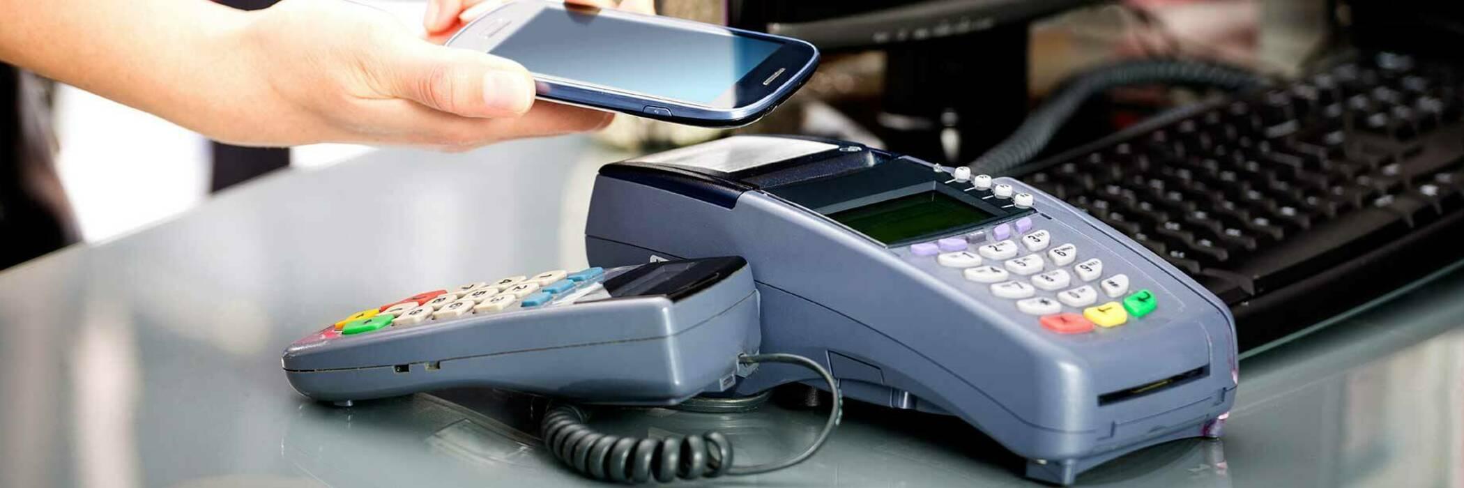 Making a payment at EFTPOS terminal.
