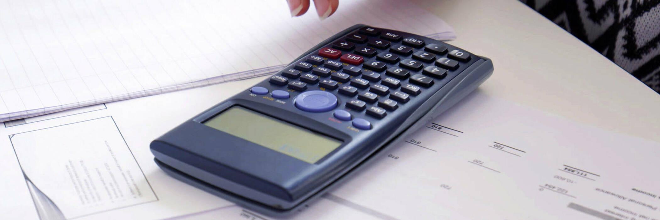Scientific calculator on paperwork
