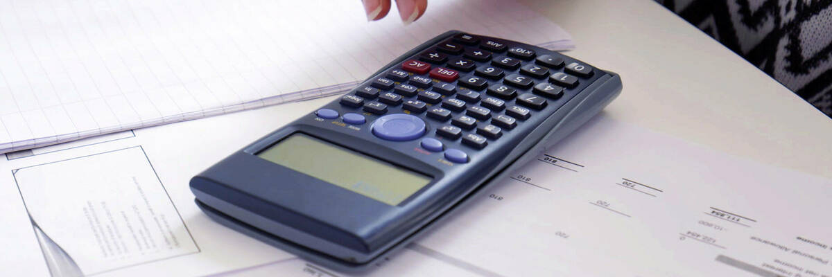 Scientific calculator on paperwork