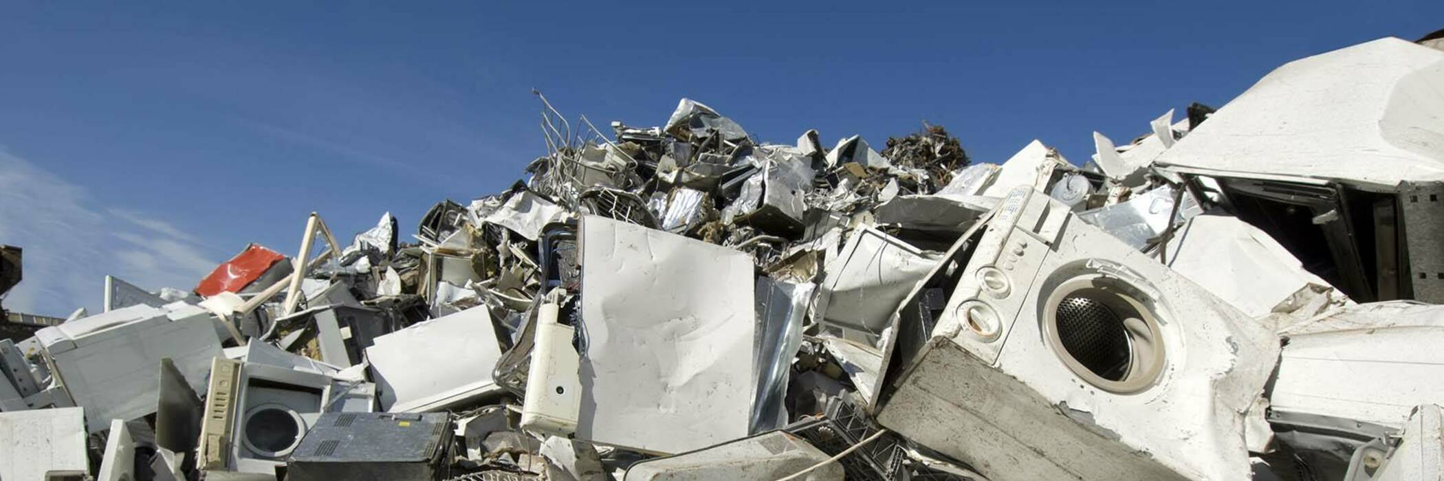 Photograph of a pile of e-waste on landfill.