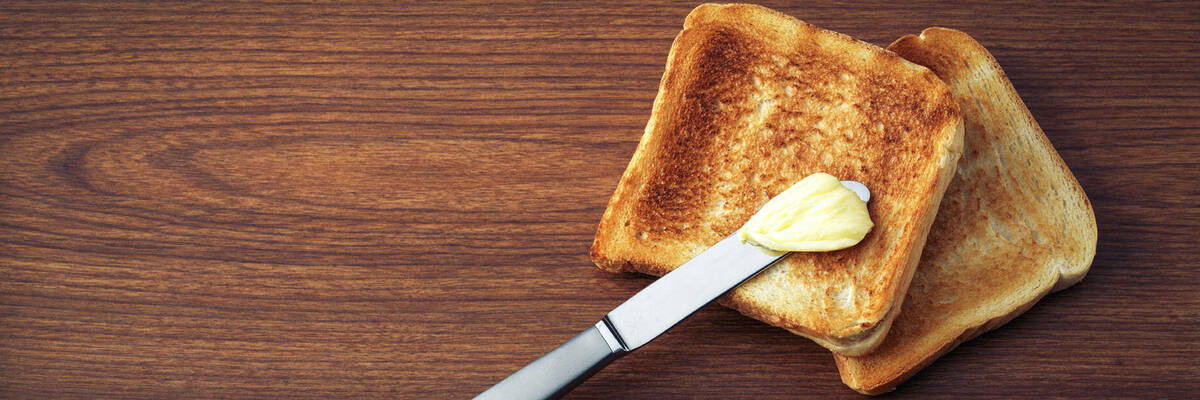spreading butter on toast
