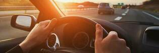Driving on motorway with both hands on steering wheel