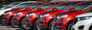 row of red and white crossover cars