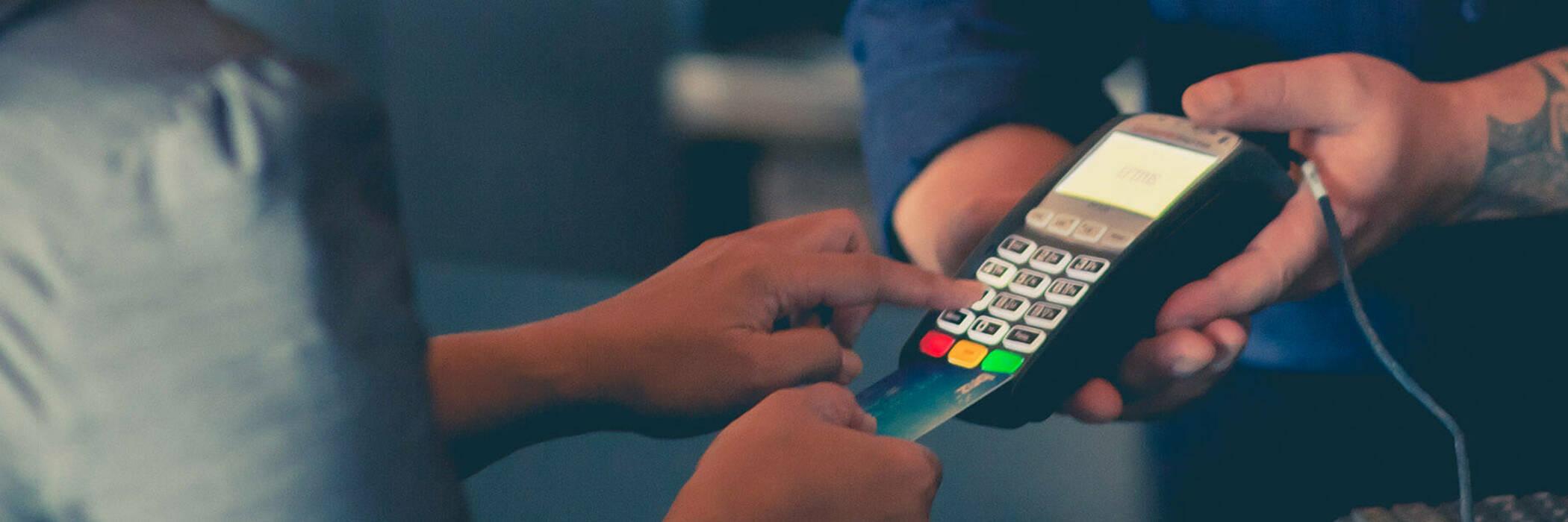 Customer paying by EFTPOS machine