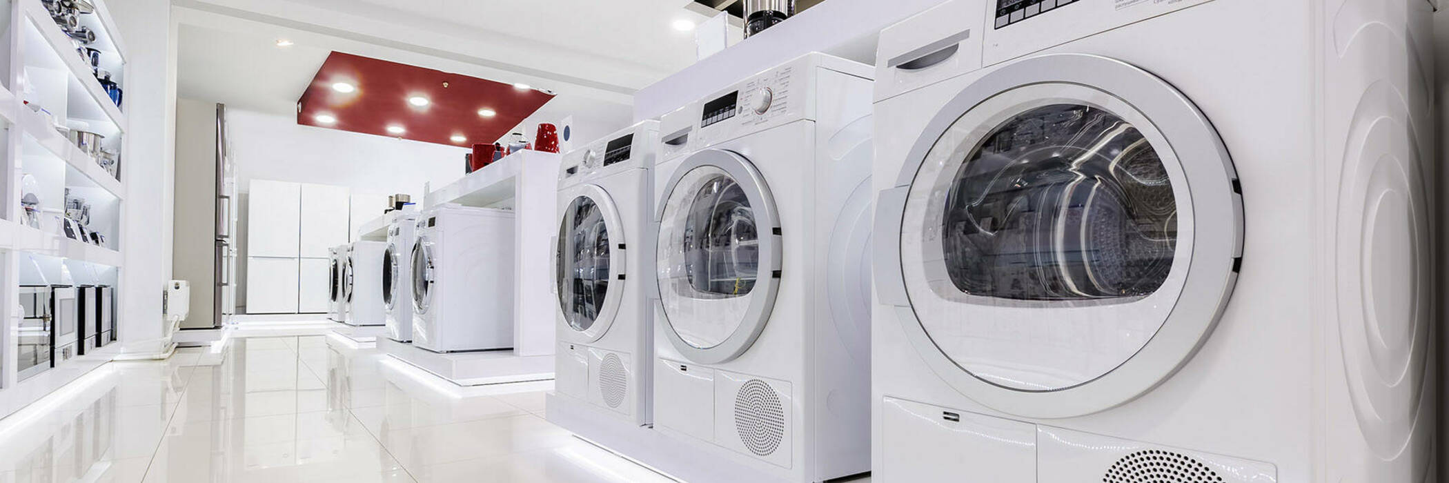 Front-loader washing machines in appliance store.