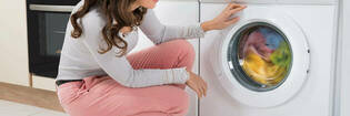 Adding washing powder to top loader washing machine