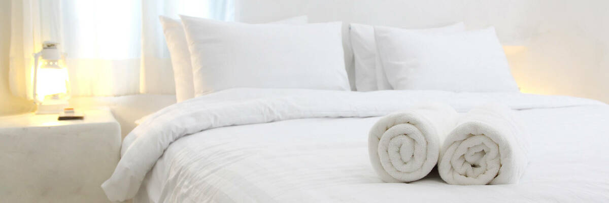 Folded towels on hotel bed