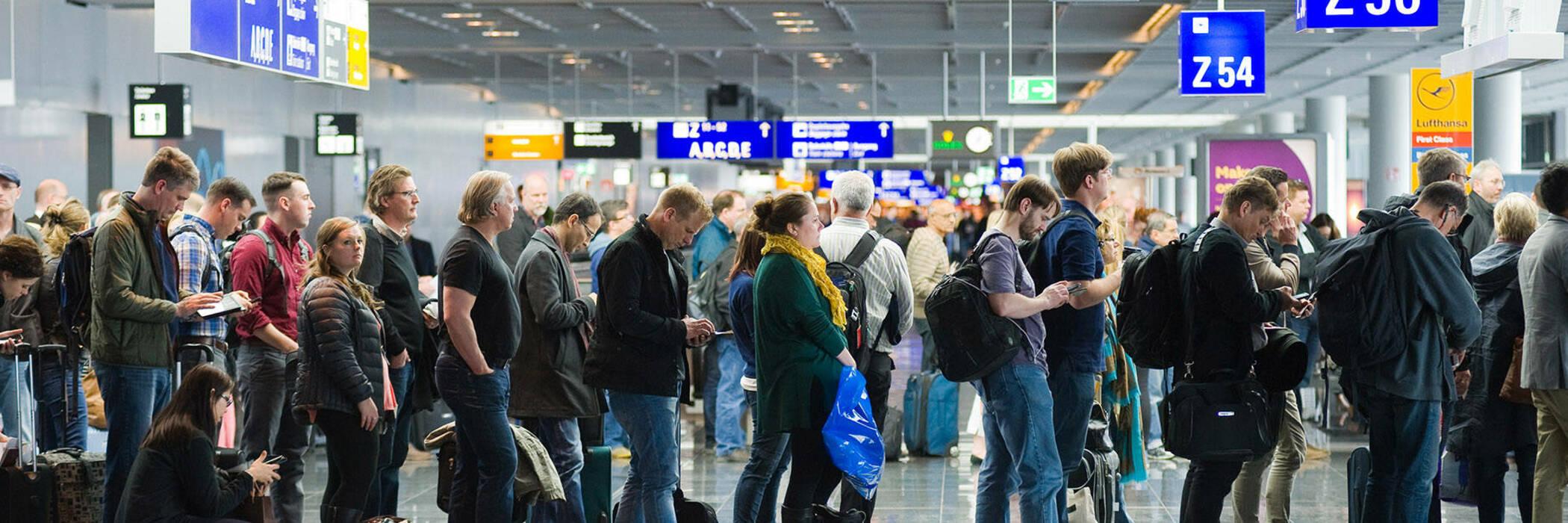 Passengers waiting in airport queue