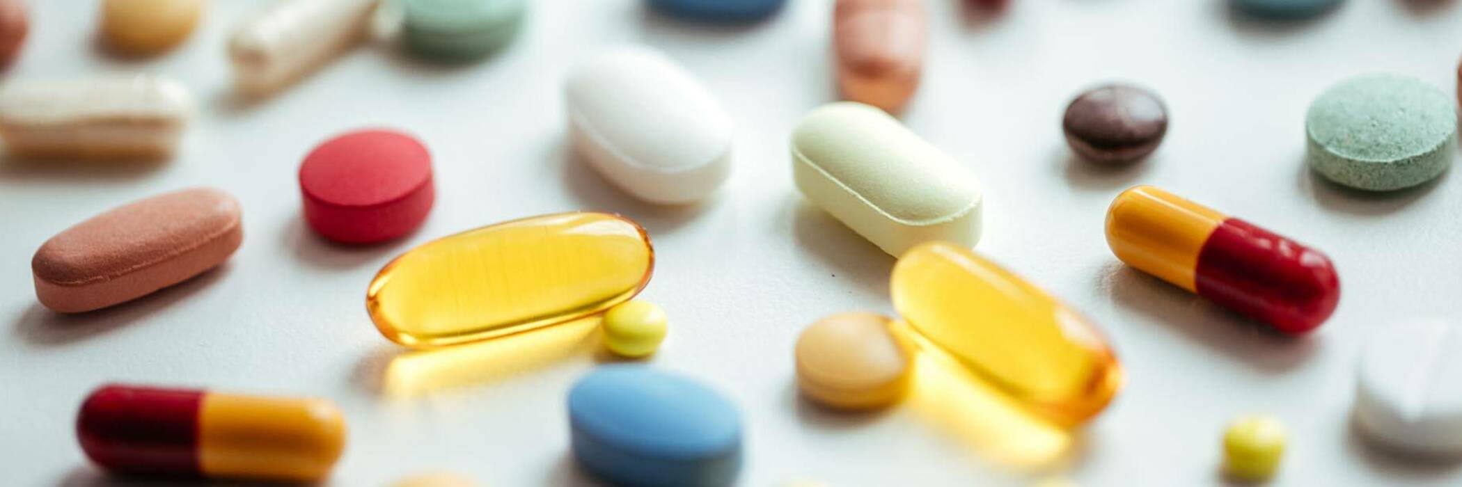Pills, tablets and capsules of various shapes and colours.