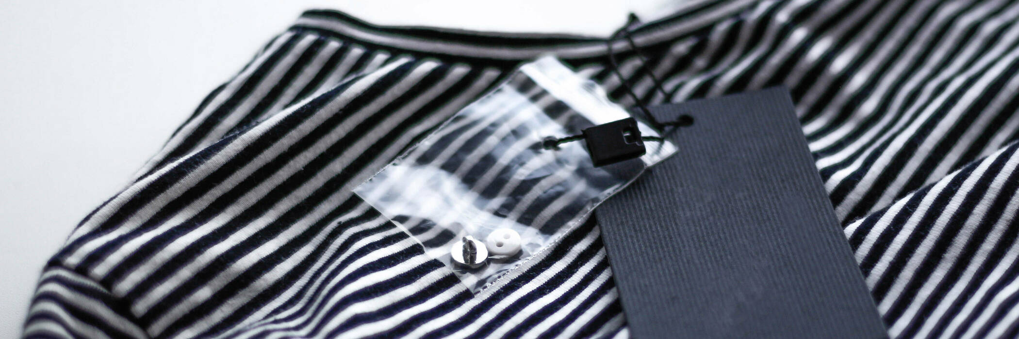 black and white striped T-shirt with tag