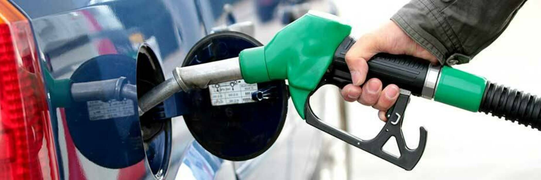 Pumping fuel into car.