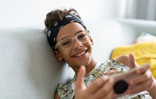 Teenager using smartphone.