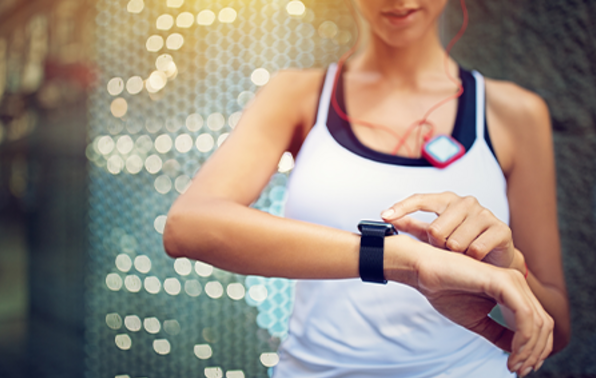 Runner checking smartwatch after exercise.