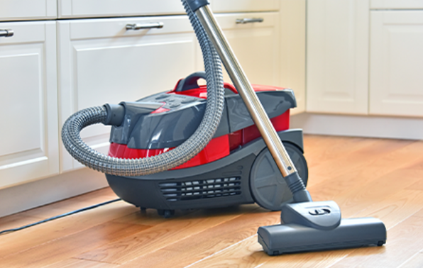 Photograph of a standard vacuum cleaner in the kitchen.