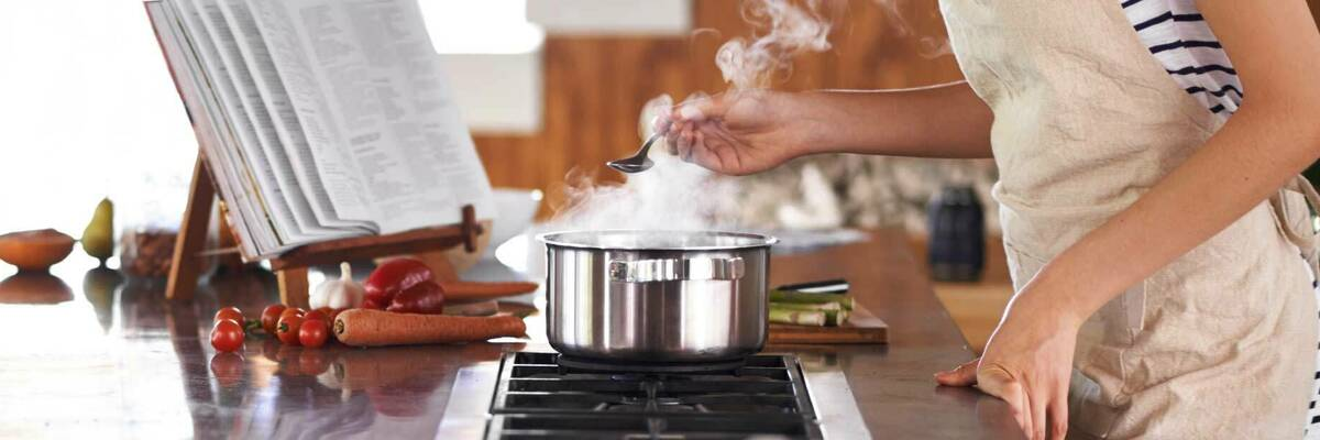 Cooking on a gas cooktop.