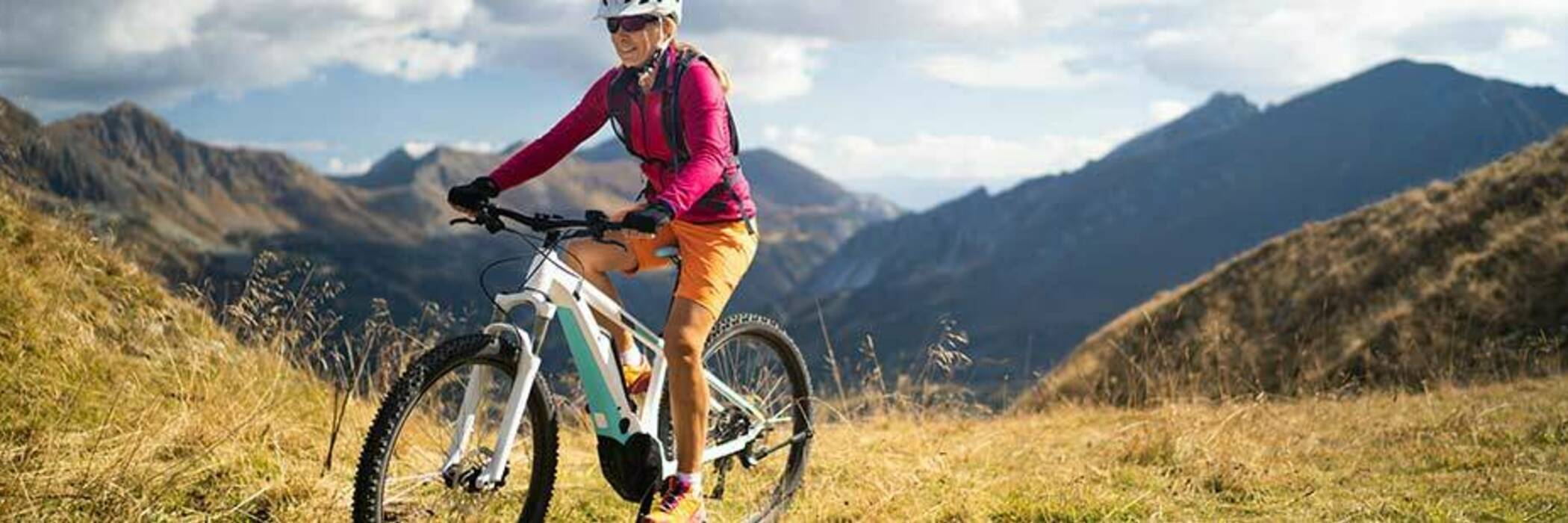 Woman on electric bike in the mountains.