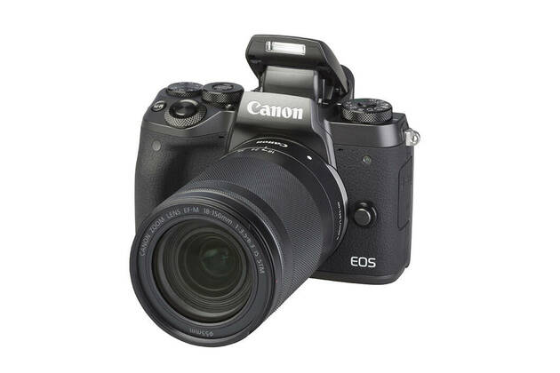 Canon EOS M5 (with 18-150mm lens)