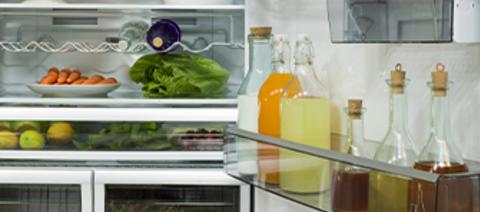 Photo of an open fridge.