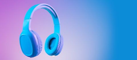 Stylish blue headphones on multi colored / duo tone background lighting.