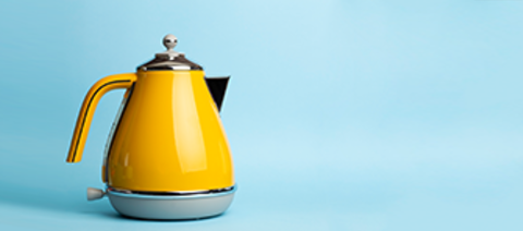 Electric vintage retro kettle on a colored blue background.