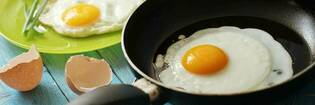 Cooking an egg in a frying pan.