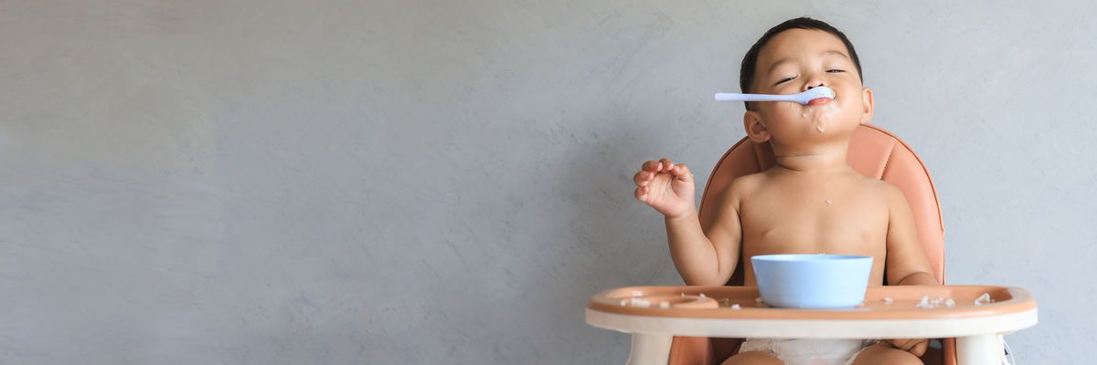 Baby in high chair.
