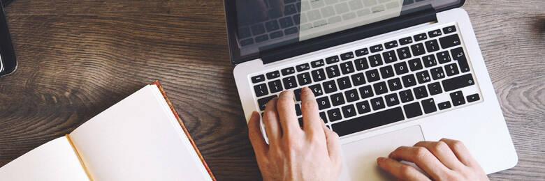 typing on a laptop keyboard.
