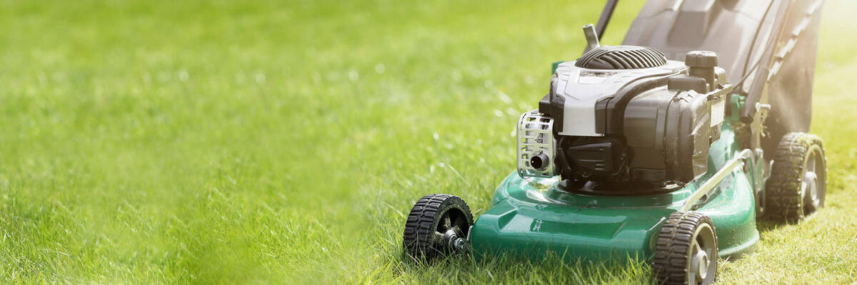 Green lawnmower on grass.