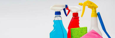 Spray bottles with cleaning tools.