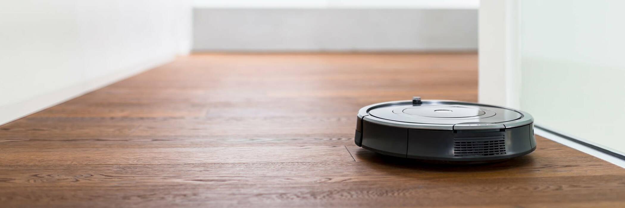 Robot vacuum cleaner in hallway