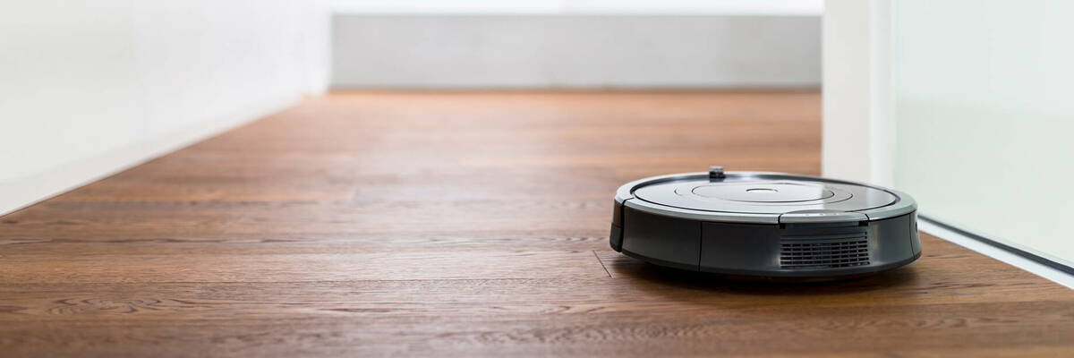 Robot vacuum cleaner in hallway