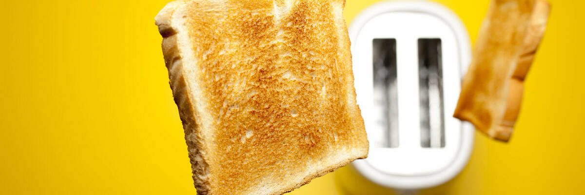 toast popping out of white toaster