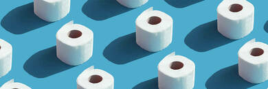 Rolls of toilet paper on blue background.
