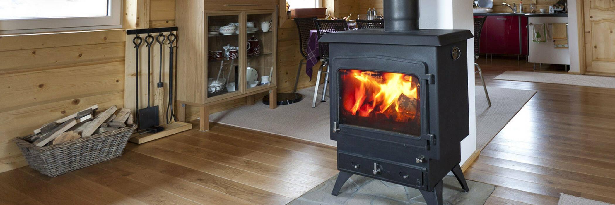 Woodburner lit inside a house.